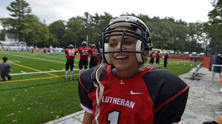 Long Island Lutheran female kicker Carolyn Dottino-Buenahora stands