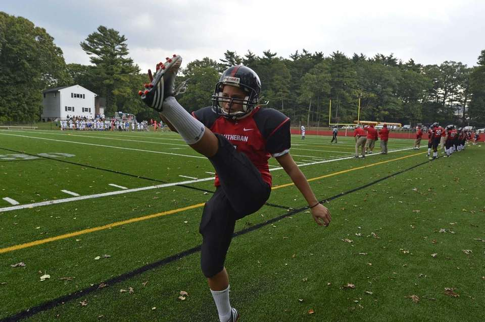 Long Island Lutheran female kicker Carolyn Dottino-Buenahora warms