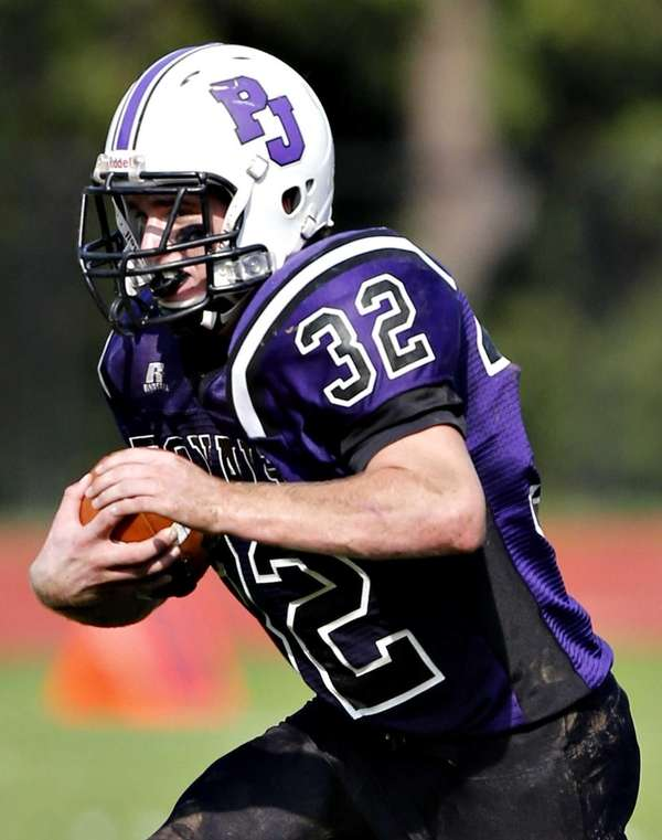 Port Jefferson running back Paul Cavanagh breaks into