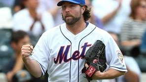 R.A. Dickey celebrates the final out of the