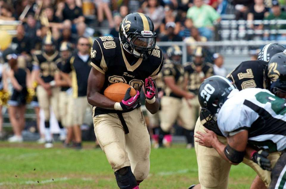 West Hempstead running back Enrique McFarlane tries to