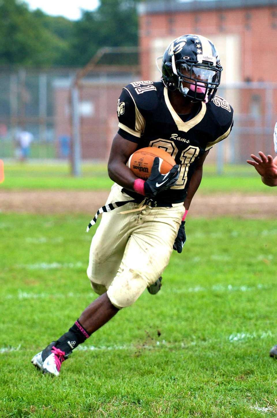 West Hempstead runnick back Tayvon Hall runs the
