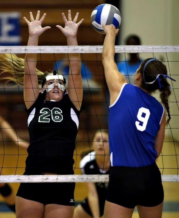 Glenn's Samantha Czeczotka spikes the ball directly toward
