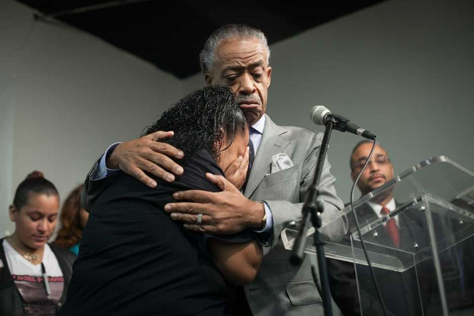 The Rev. Al Sharpton consoles Cecilia Reyes, mother