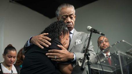 The Rev. Al Sharpton consoles Cecilia Reyes, mother