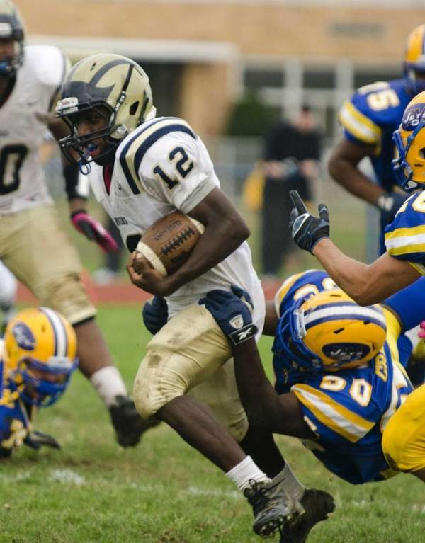 Baldwin's Jovaun Tomlinson runs for some yardage during