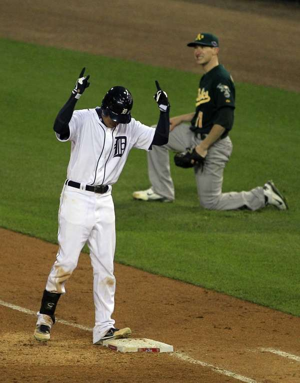 The Detroit Tigers' Quintin Berry reacts after safely