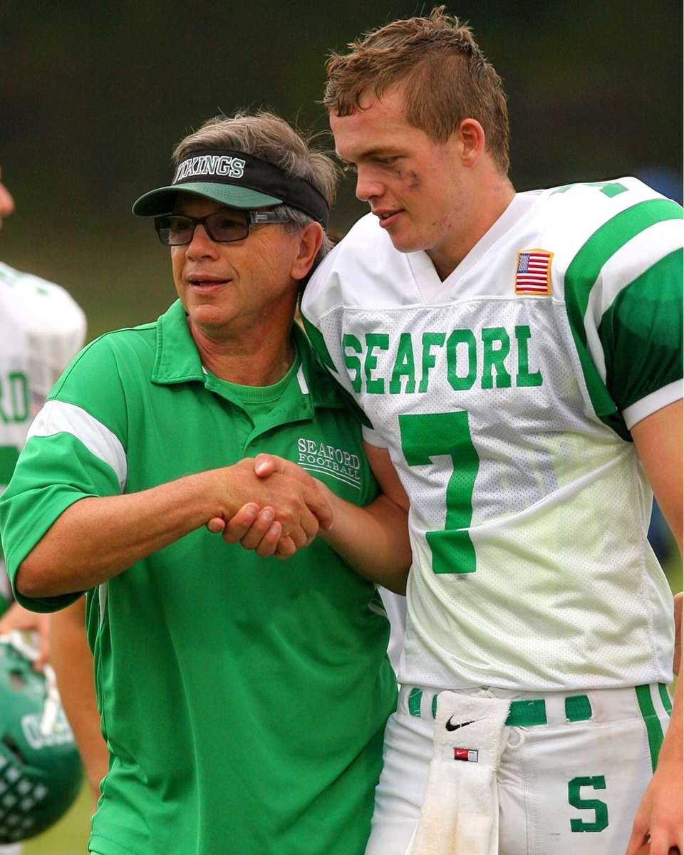 Seaford High School's head coach Rob Perpall congratulates