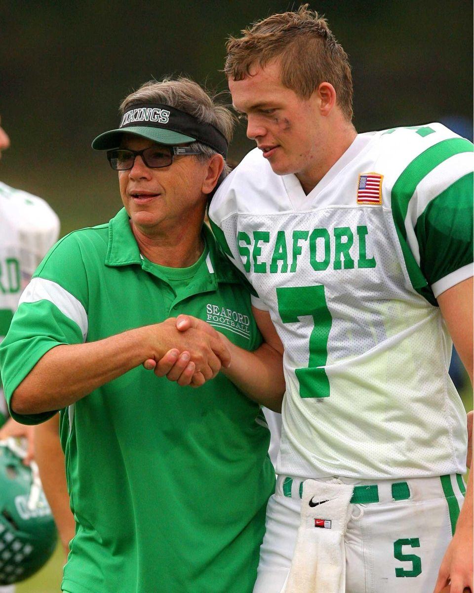 Seaford High School's head coach Rob Perpall congratulates