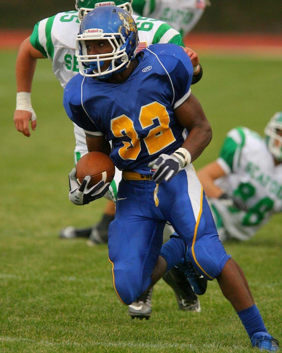 Roosevelt High School's Johnnie Akins runs for a