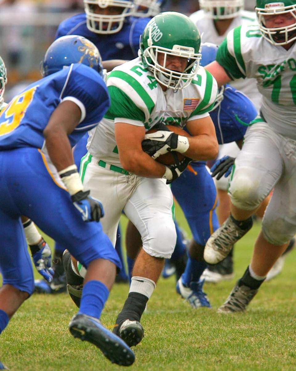 Seaford's Nick Fischetti gains some yards in varsity