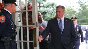 Nassau County Executive Edward Mangano attends the wake