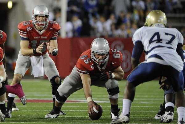 Stony Brook quarterback Kyle Essington sets up for