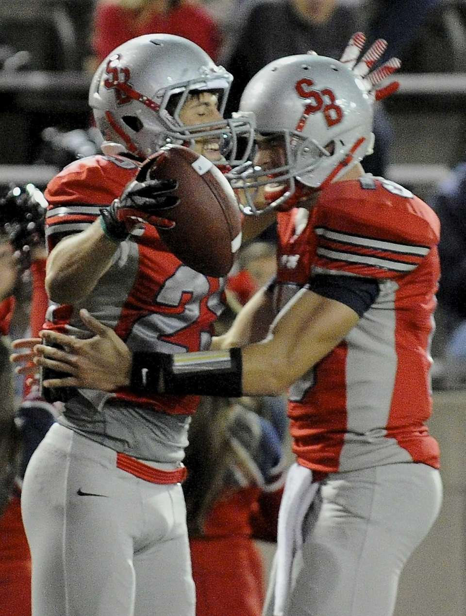 Stony Brook's Jordan Gush, left, celebrates his second