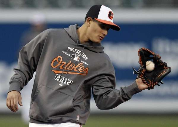 Baltimore Orioles third baseman Manny Machado takes part