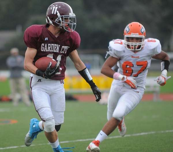 Garden City wide receiver Brian Badgett, left, picks