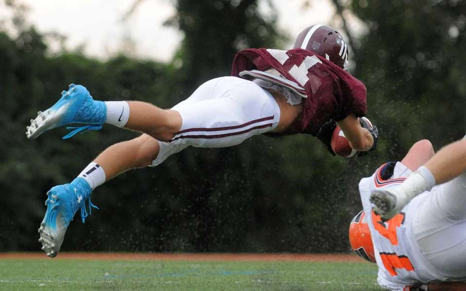 Garden City's wide receiver Brian Badgett leaps into