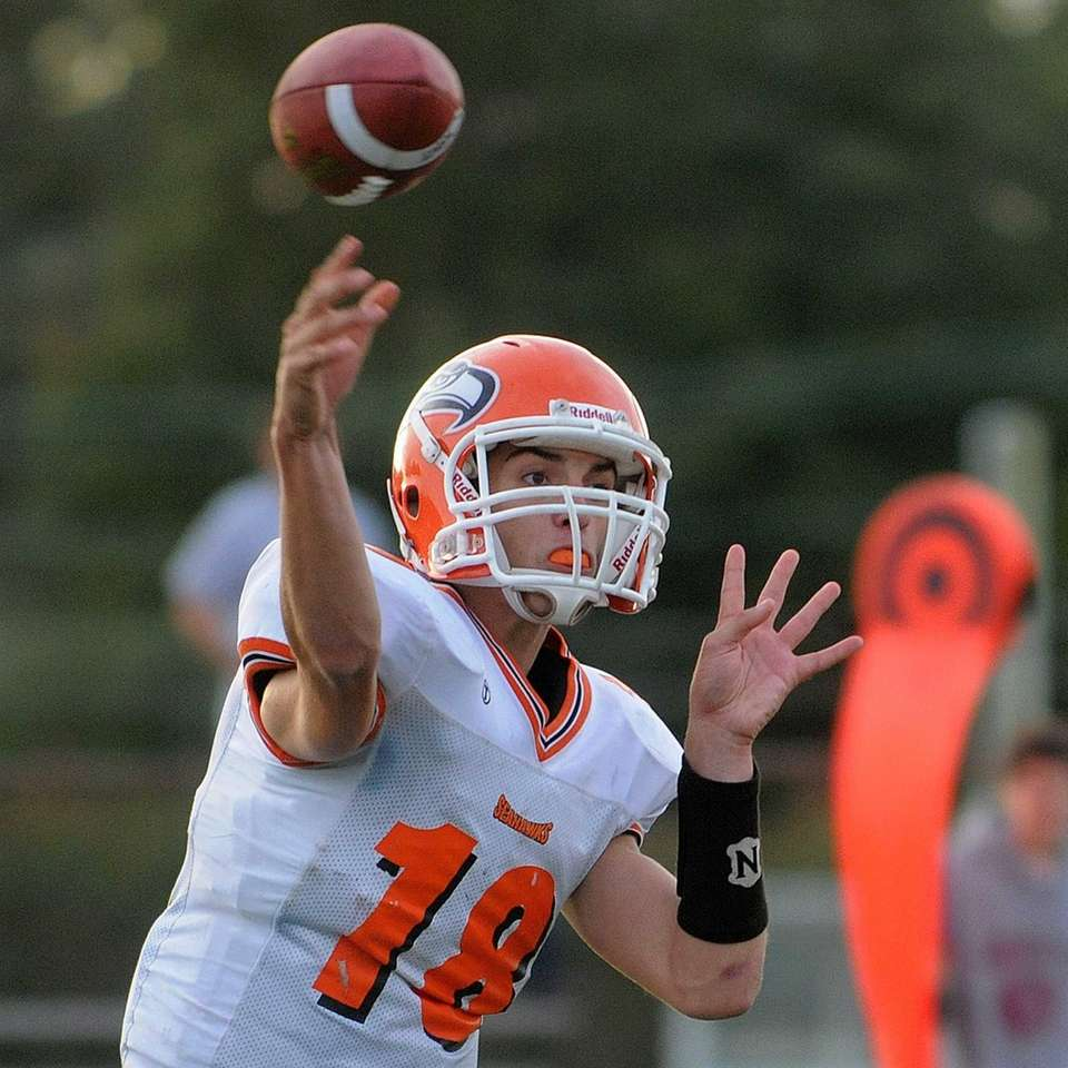 Carey High School quarterback Raymond Catapano throws a