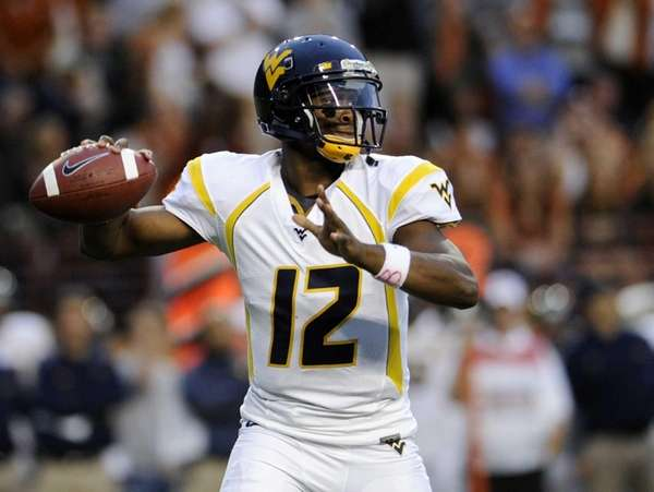 West Virginia quarterback Geno Smith looks for a