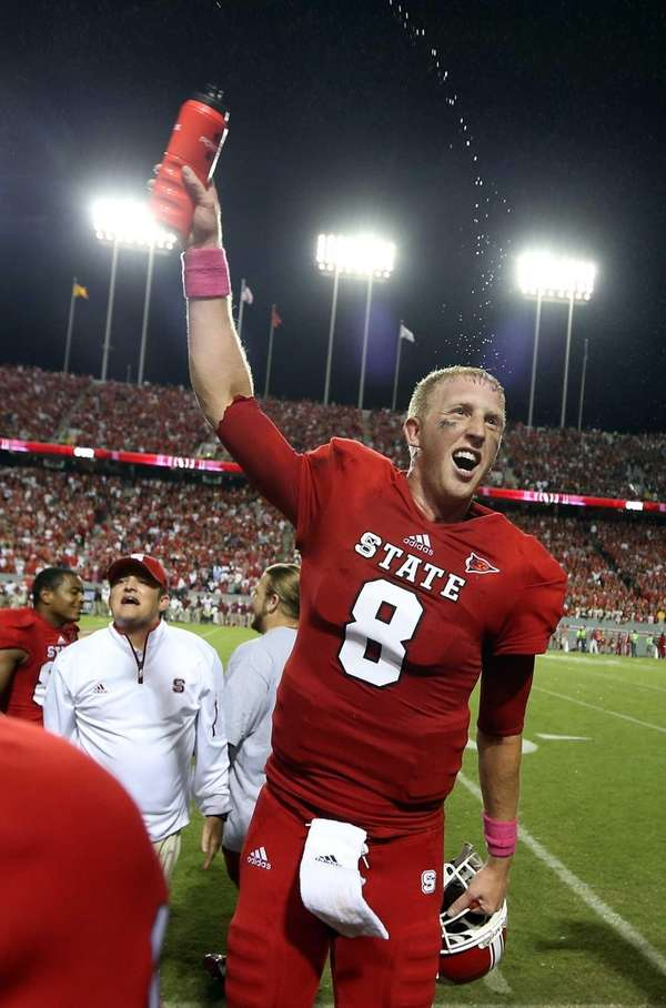 North Carolina State's Mike Glennon celebrates after defeating