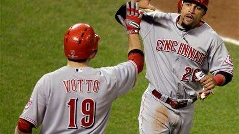 The Cincinnati Reds' Xavier Paul, right, celebrates with