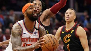 The Knicks' Marcus Morris Sr., left, drives against