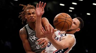 Nicolas Claxton of the Nets fouls Ben Simmons