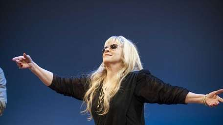Singer Stevie Nicks greets the audience at the
