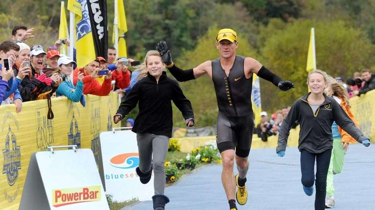 Lance Armstrong crosses the finish line of the