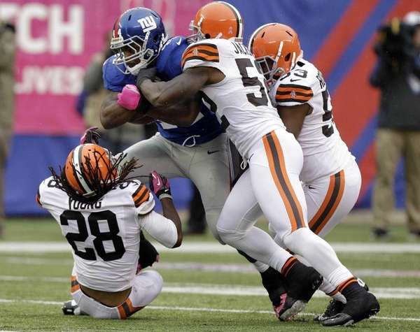 Giants running back Ahmad Bradshaw is tackled by