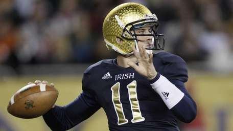 Notre Dame quarterback Tommy Rees drops back to