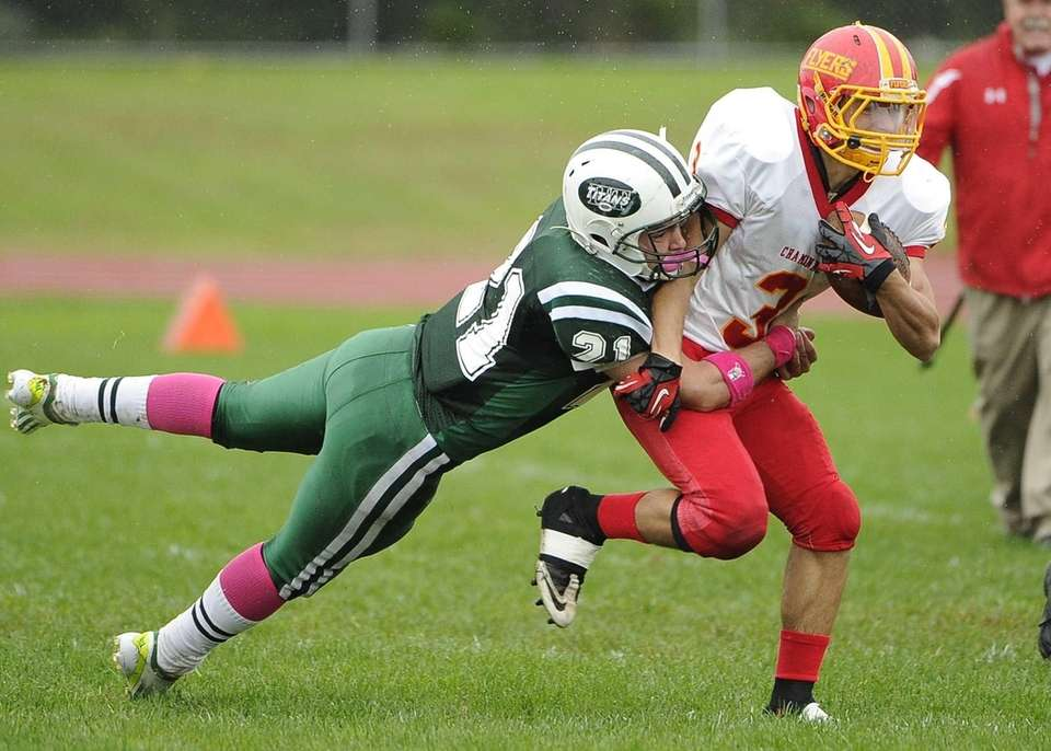 Chaminade's Matt Correa is tackled by Holy Trinity's
