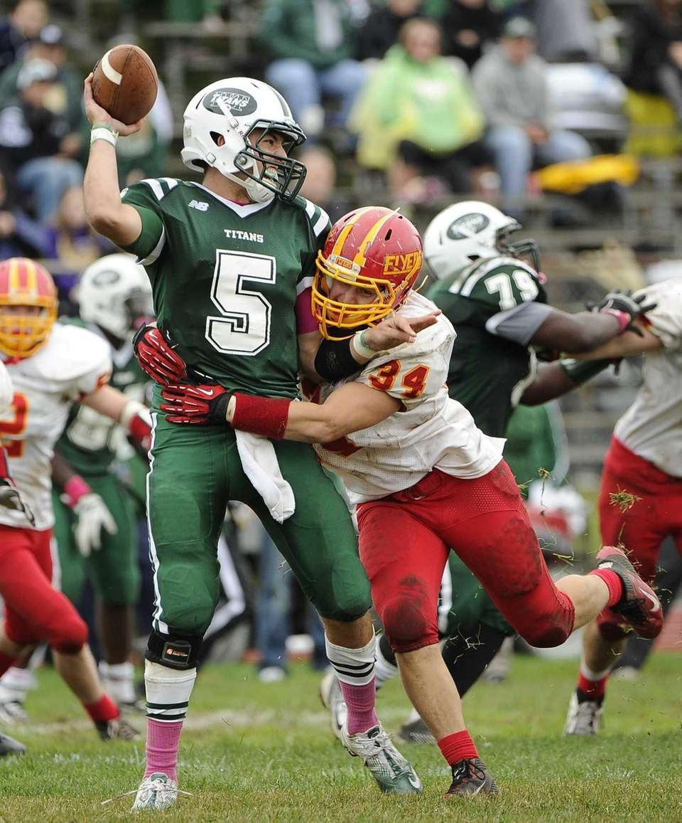 Holy Trinity quarterback Chris Laviano completes his pass