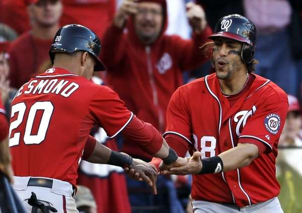 Washington Nationals' Ian Desmond, left, and Michael Morse