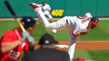 Adam Wainwright pitches during the first inning against