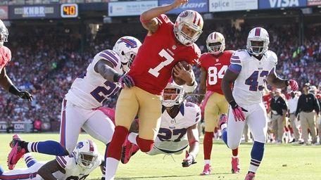 San Francisco 49ers quarterback Colin Kaepernick (7) runs