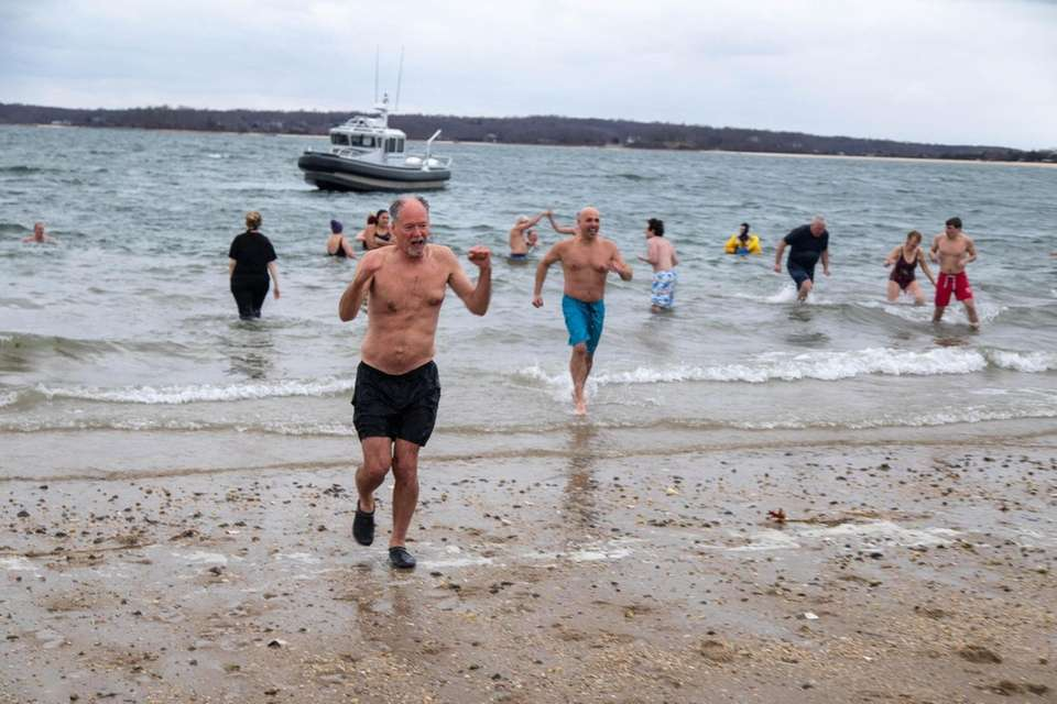Plungers leave the water during the 11th annual