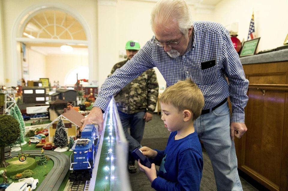 Brewster Gottsch of Mamaroneck, 5, operates a train