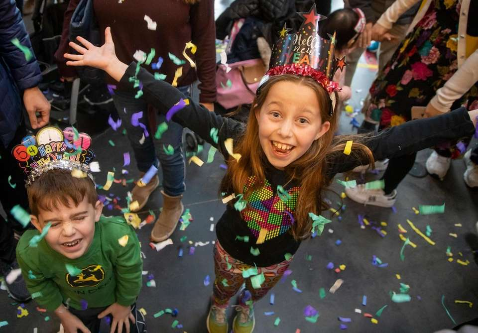 Noah, 6, and Lucy Moss, 8 Melville, celebrate