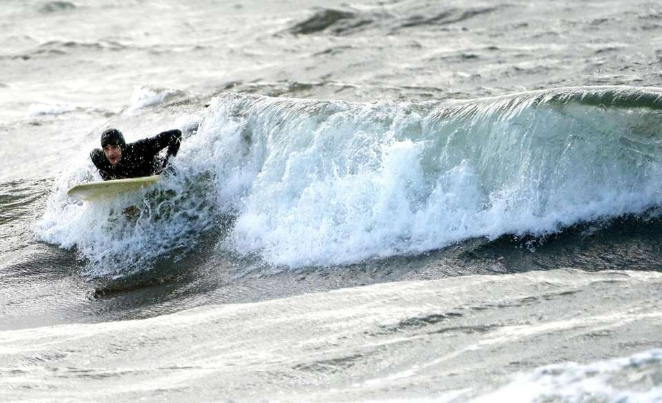 Gil Luis of NYC surfs at Lido Beach,