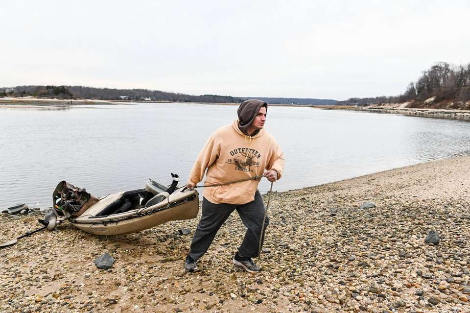 Mike Serra, of Bethpage, drags his kayak onto