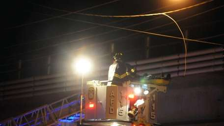 Rescue personnel lower a a Yonkers man later