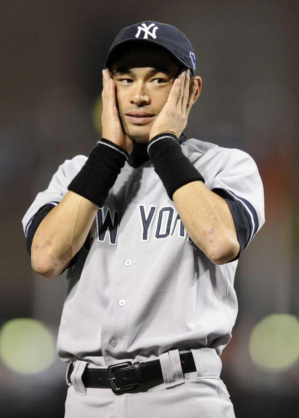 New York Yankees left fielder Ichiro Suzuki reacts