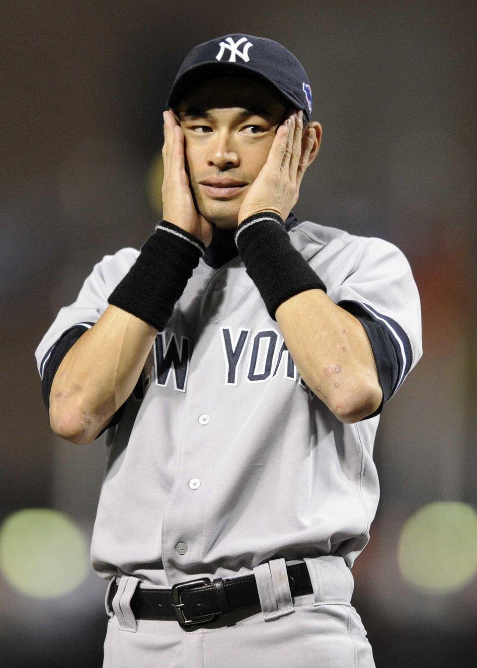 New York Yankees left fielder Ichiro Suzuki reacts