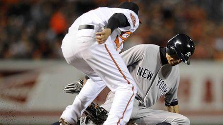 Baltimore Orioles third baseman Manny Machado tags out