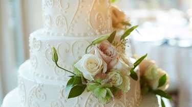 A finished decorated wedding cake from Francesco's Bakery