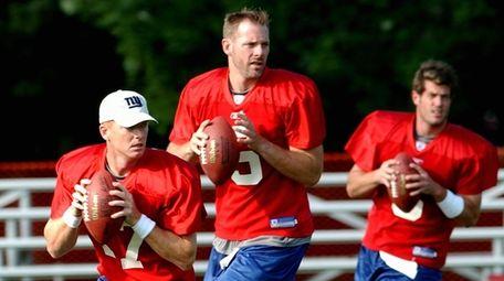 Giants quarterbacks, from left, Jason Garrett, Kerry Collins