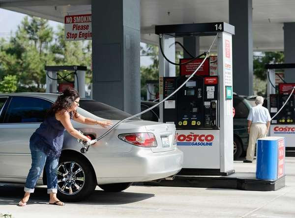 Customers gas up their car at Costco Wholesale
