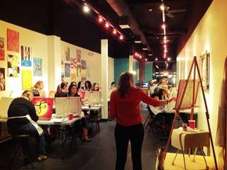 At Paint the Town studio in Huntington, grownups