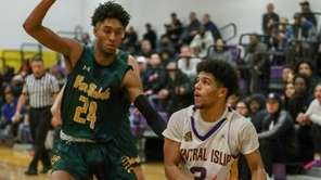 Ward Melville's Myles Brown plays defense against Central